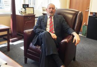 Attorney Andrew Luger, Minnesota's senior prosecutor, who is spearheading efforts to prevent youth in Minneapolis from joining ISIS, is pictured in his office in Minneapolis