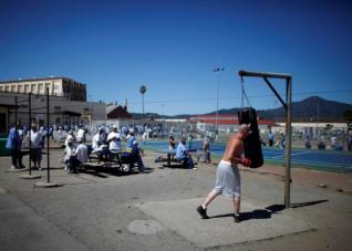 Chris Willis, 34, works out in the exercise yard at San Quentin state prison